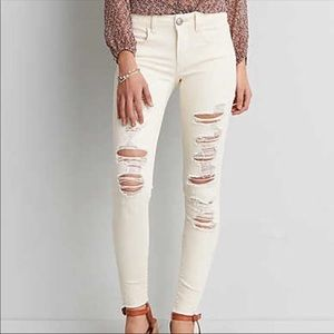 American Eagle Ivory Skinny Ripped Jeans